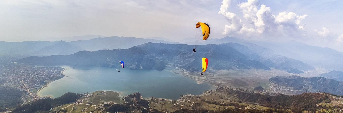 Paragliding over Fewa Lake